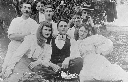 Media on Mars project thumbnail: Old black and white photos of a group of people sitting on the grass