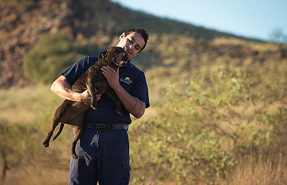 Media on Mars project thumbnail: Ranger holding a dog in his arms