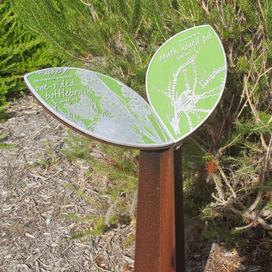 Media on Mars service thumbnail: Metal sign in the shape of a leaf with botanical information on the leaves