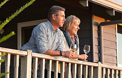 Media on Mars project thumbnail: Older couple on balcony of cabin drinking wine