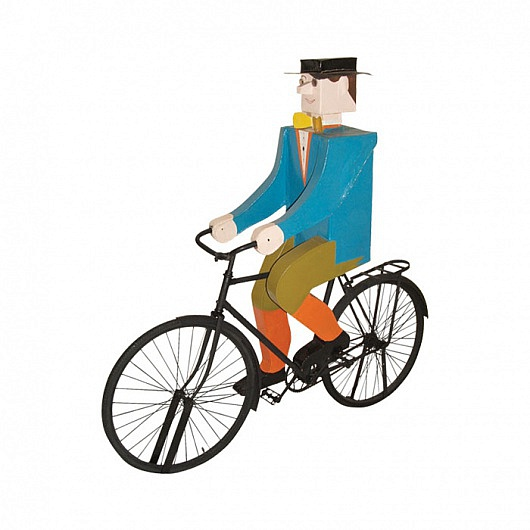 Life-size model of a man on a bicycle made of tin