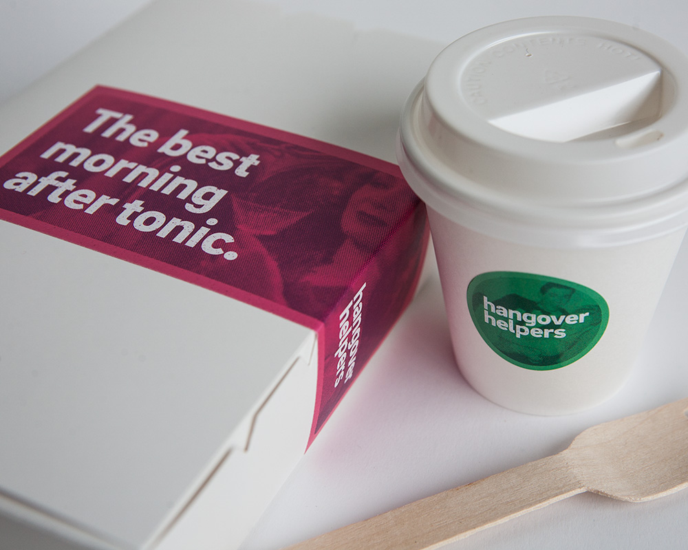 Image of branded items from the Hangover Helpers project: lunchbox and coffee cup