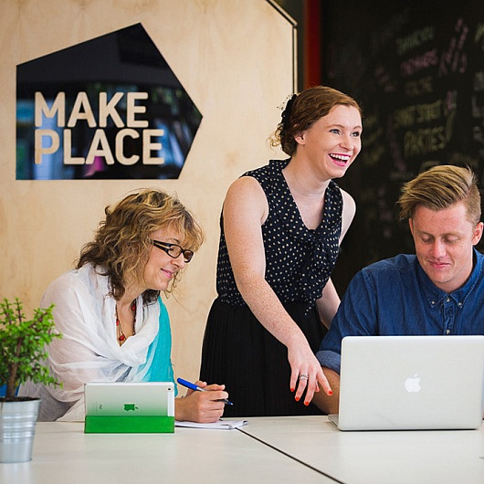 Group of smiling people in MakePlace, a coworking space in Mandurah