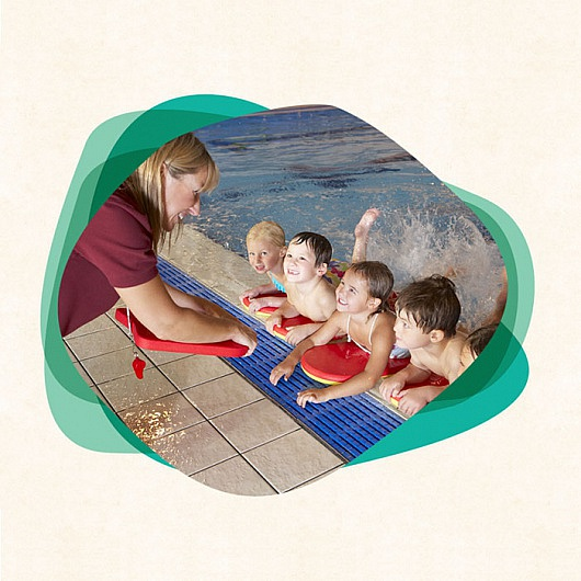 Swimming teacher at pool with kids