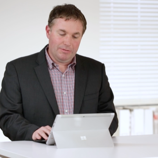 Man in business suit using iPad