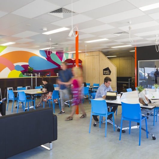 Colourful coworking space with people working at desks