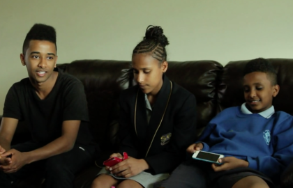 Media on Mars video thumbnail: Refugee siblings sitting on their family couch talking to camera