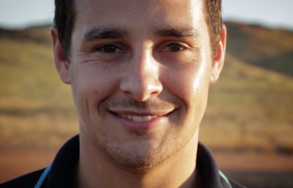 Media on Mars video thumbnail: Young man standing in Australian landscape smiling at camera