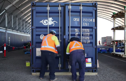 Media on Mars video thumbnail: Two workers wearing high-vis vests closing a sea container