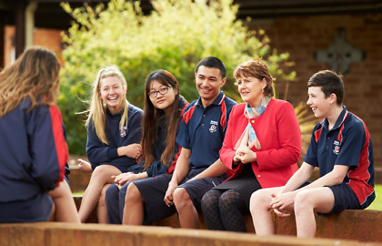 Media on Mars project thumbnail: Warwick High School principal sitting with students outdoors
